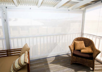 White rope and pulley blinds on elevated deck