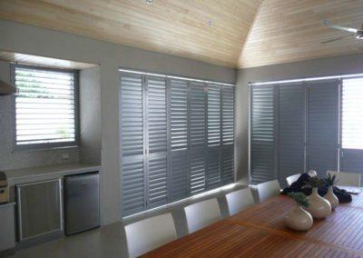 aluminium shutters in outdoor dining area