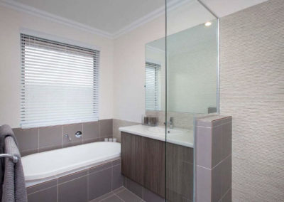 bathroom with venetian blinds