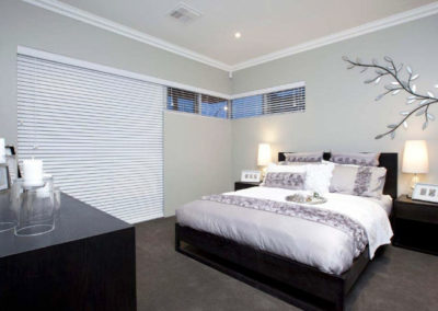 bedroom with large venetian blinds