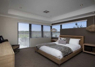 bedroom with large windows and venetian blinds