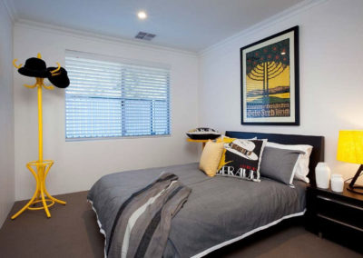 bedroom with pops of colour and venetian blinds