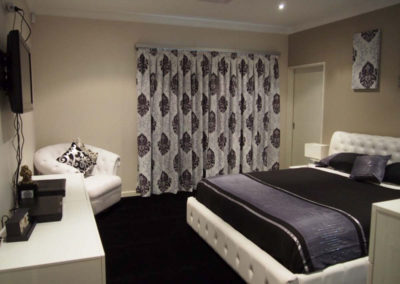 bedroom with purple damask curtains