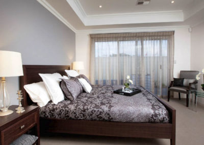 bedroom with sheer curtains