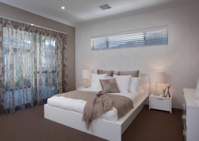 bedroom with sheer patterned curtains
