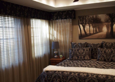 bedroom with taupe sheer curtains