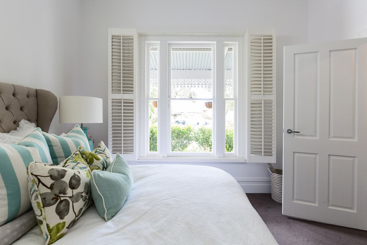 bedroom with white shutters