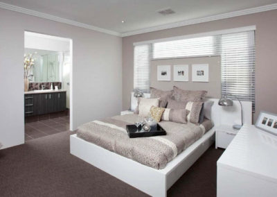 bedroom with white venetian blinds
