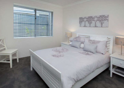 bedroom with white venetians