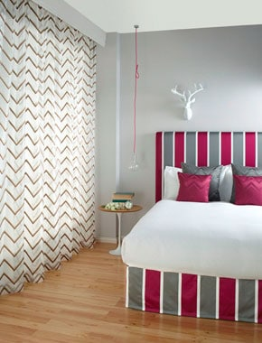 bedroom with zigzag curtains