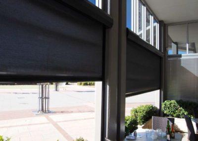 black Ziptrak blinds halfway down