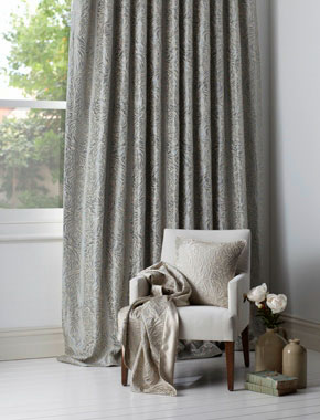 grey patterned curtains with chair