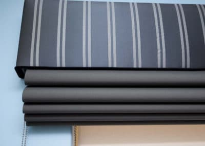 grey roman blinds with striped pelmet