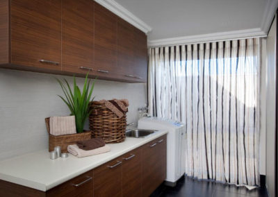 laundry room with striped curtains