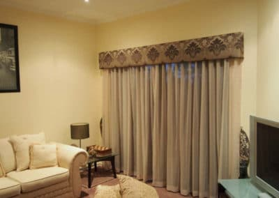 living room with damask pelmet