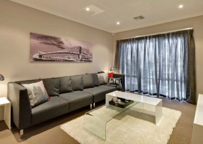 living room with grey sheer curtains