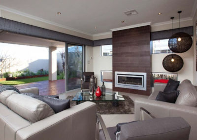 living room with open outdoor deck and padded pelmets