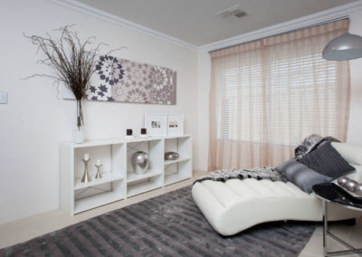 living room with venetian blinds and sheer curtains