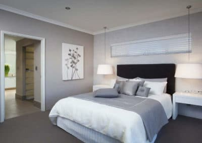 narrow venetian blinds above bed