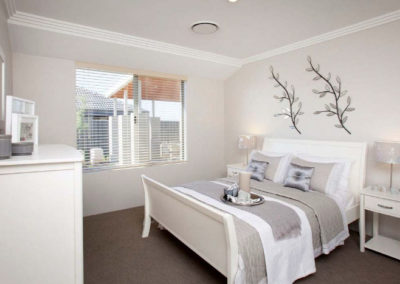 neutral bedroom with venetian blinds
