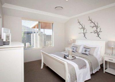neutral bedroom with venetian blinds