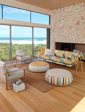 open home with patterned fabric couches and chairs