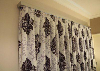 purple damask curtain detail