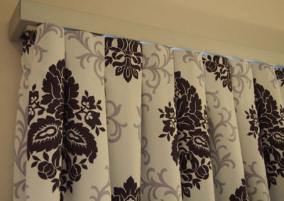 purple damask curtain detailing