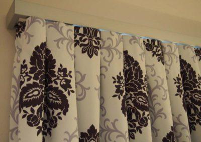 purple damask curtain detailing