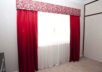 red curtains with floral pelmet