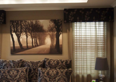 room with brown pelmets and taupe curtains
