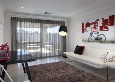 room with grey sheer curtains