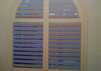 shutters over arched window