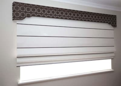 striped roman blinds with decorative pelmet