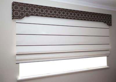 striped roman blinds with decorative pelmet