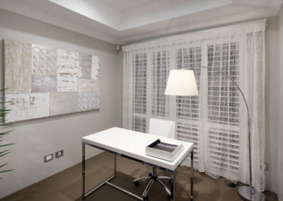 study with sheer lace curtains and shutter blinds