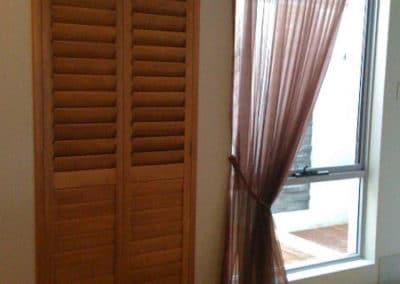 tall natural wood shutters