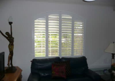 white arch window shutters