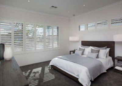 white bedroom with shutters