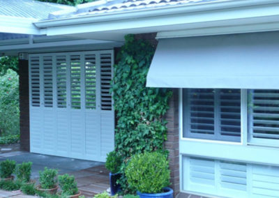 white indoor outdoor shutters