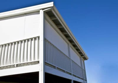 white outdoor blinds on balcony