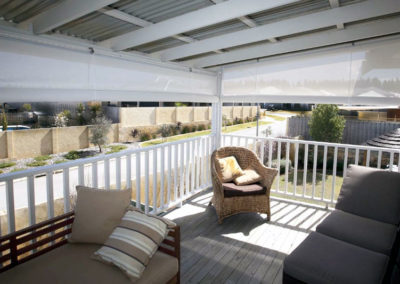 white outdoor blinds on deck