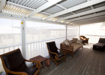 white rope and pulley blinds on elevated deck patio