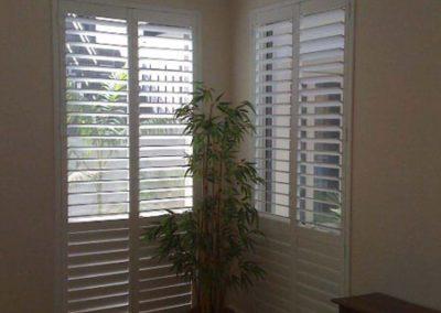 white shutter over tall windows
