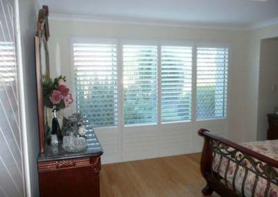white shutters in bedroom