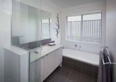 white venetian blinds in bathroom