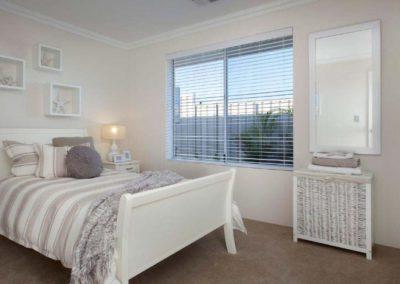 white venetian blinds in bedroom